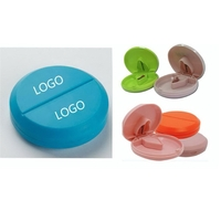 Plastic pill case with cutter