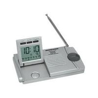Slim traveler AM/FM radio/alarm clock/flashlight