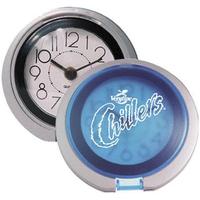 Flip-open travel alarm clock with translucent lid