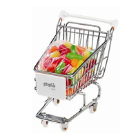 Mini shopping cart filled with Mike and Ikes fruit candy