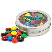 Candy covered chocolatey beads in circular window tin